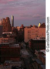 New York City Manhattan against sunset sky