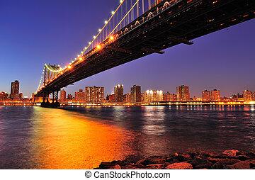 New York City Manhattan Bridge over East River at dusk...