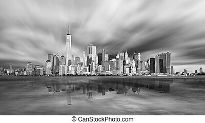 New York City Manhattan downtown skyline in evening with stormy sky