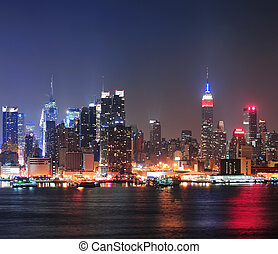 New York City Manhattan midtown skyline at night with...