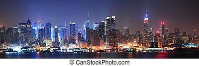 New York City Manhattan midtown skyline at night with...