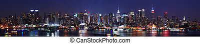 New York City Manhattan skyline panorama at night over ...