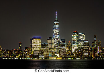 New York City Manhattan skyline panorama at night over Hudson river with reflections viewed from New Jersey