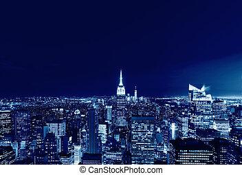 New York City Manhattan skyline panorama at night, USA