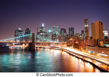 New York City Manhattan skyline and Brooklyn Bridge with...