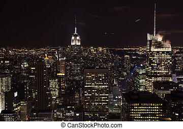 New York City Skyline East River Empire State Building Night...