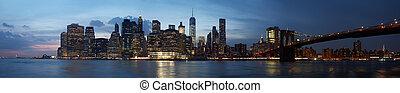 New York city skyline panorama with Brooklyn bridge at sunset