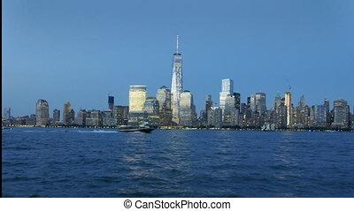 New York city skyline - Neaw York city by night with boats...