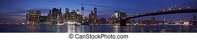 New York city skyline with Brooklyn bridge at dusk