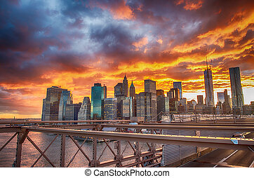 New York City. Terrific sunset view from Brooklyn Bridge with Sk