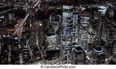 New York City , USA, Aerial - Close-up view of the One World Trade Center building at Night as seen from a helicopter