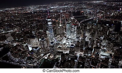 New York City , USA, Aerial - Wide angle view of the Financial district at Night as seen from a helicopter