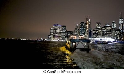 NEW YORK CITY, USA - DECEMBER 5, 2018: Ferry crossing Brooklyn to Manhattan at night, slow motion.