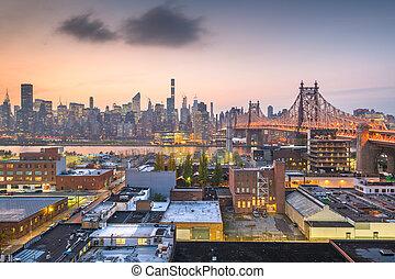 New York, New York, USA Manhattan skyline with the Queensboro Bridge.