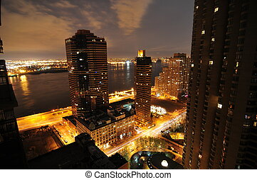 New York's Midtown East at Night. View unto apartment buildings and the East River.