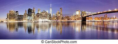 New York panorama with Brooklyn bridge at night, USA