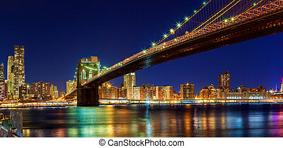 New York - Panoramic view of Manhattan Brooklyn Bridge by night, big size