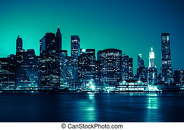 New York - Panoramic view of Manhattan Skyline by night -...