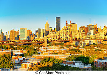New York, Queensborough Bridge across the East River between...