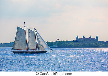 New York sailboat sunset and Ellis Island