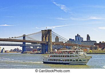 Ferry near Brooklyn bridge and Manhattan bridge over East River