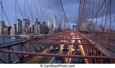 New York USA Manhattan skyline from the Brooklyn bridge at dusk