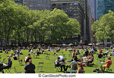 NEW YORK, USA - MAY 16: People enjoying a nice day in Bryant Park on May 16, 2013 in New York City, NY. Bryant Park is a 9,603 acre privately managed park in the center of Manhattan.