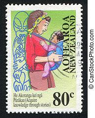Maori woman with a child - NEW ZEALAND - CIRCA 1995: stamp...