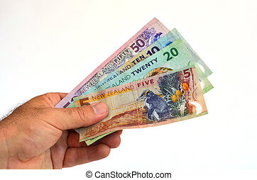 New Zealand Dollar banknotes - Mans hand holds New Zealand...