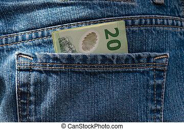 New Zealand dollars in pocket