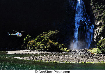 New Zealand Fiordland - A helicopter flies over Fiordland, ...