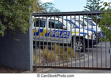 KAITAIA, NZL - AUG 18 2014:NZ Police cars park in Police station. Crime in New Zealand is officially low, However many crimes go unreported, especially sexual crimes, and do not appear in official statistics.