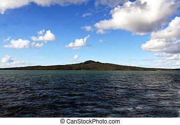 View of Rangitoto island from a passenger ferry boat traveling to Waiheke island, New Zealand.