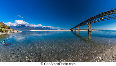 New Zealand's longest one-lane bridge over Haast River, South Westland