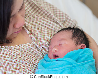 Newborn Asian baby and mother - Newborn Asian baby girl...