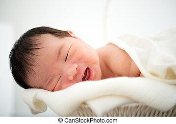Newborn Asian baby girl smiling