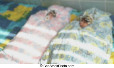 Newborn babies lying on a medical couch. Close up