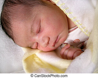 newborn baby - a dark haired one day old baby peacefully...
