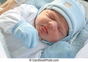 Newborn baby. - After childbirth, newborn baby in hospital.