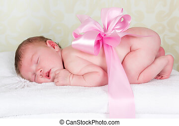 Newborn baby as a gift - Little newborn baby wrapped with a...
