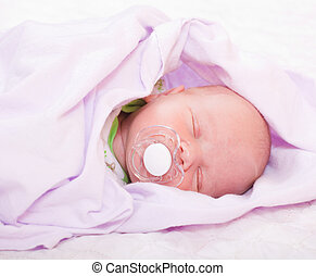 newborn baby (at the age of 7 days)