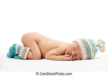 Newborn baby boy asleep over white background