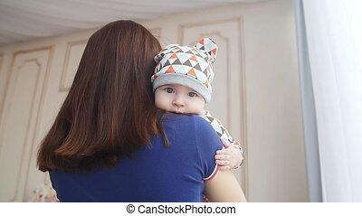 Newborn baby boy in mother's arms - Newborn baby boy asleep...