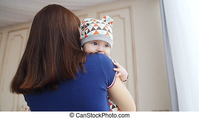 Newborn baby boy in mother's arms