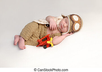 Newborn Baby Boy Wearing an Aviator Outfit
