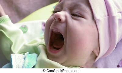 Newborn baby crying. Cute hungry child weeping.