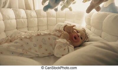 Newborn baby girl about to sleep in her cradle - Newborn...