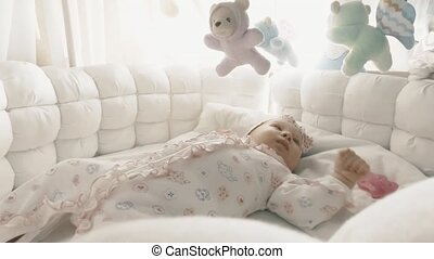 Newborn baby girl in her bed