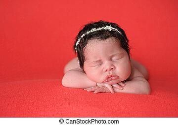 Newborn Baby Girl Wearing a Rhinestone Headband