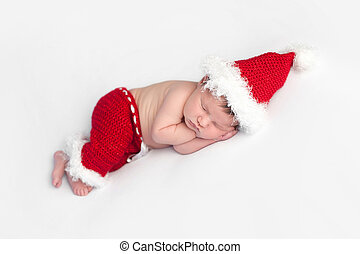 Newborn Baby Girl Wearing a Santa Suit